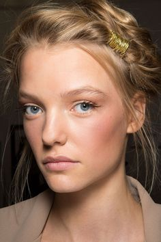 You can always count on Ferretti to deliver romance and this season, it came in the form of soft, ethereal twists, wrapped with gold thread to mimic jewelry. Paired with nothing more than gorgeously bronze skin and flirty, flared lashes, it was pure fairytale in the most wearable way. - HarpersBAZAAR.com