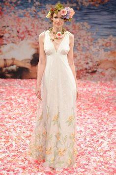 Floral print wedding dress with deep V neckline by Claire Pettibone