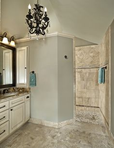 Old Shepard Master Bath Walk-In Shower.  Spa-experience.  River Rock floor massages feet, stone and mosaic glass design.