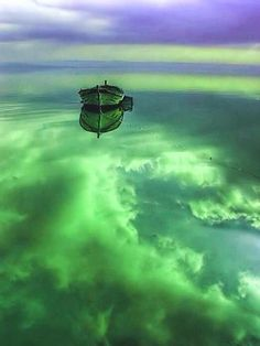 ~~still canoe on cloud-filled placid water ~ so peaceful~~