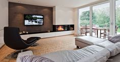 Modern corner fireplace with Bose VideoWave system and fitted wardrobes. Back wall with lime-marble spatula technique. Home Fireplace, Modern Fireplace, Living Room With Fireplace, Fireplace Design, Fireplaces, Living Room Tv, Home And Living, Home Deco, Muebles Living