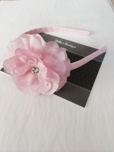 Beautiful pink flower with rhinestone center on milliesbowtique.etsy.com