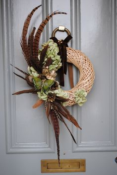 Willow wreath with pheasant feathers and hydrangea  £45.00  www.babylonflowers.co.uk