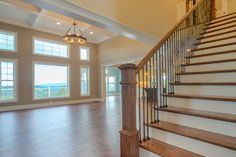 Beautiful wood staircase and an open family room.