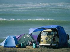 . on Oceans Edge with Tents, VW Camper and Surfer in a Chair Fotoprint