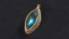 Author Irina Miech demonstrates how to bezel a cabochon with wire netting as described in her book, Wire Jewelry: Beaded and Beautiful.