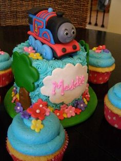 Thomas Themed Smash Cake for a little girls Birthday.  Everything made from scratch, including Thomas!