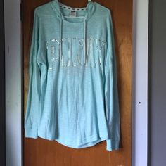 Victoria's Secret PINK open back hoodie NWOT. Perfect for the beach! The back is open. It's an aqua blue color. And kind of a terry cloth material. Very pretty! No low balls it's in perfect condition and I spent good money on it!  PINK Victoria's Secret Tops
