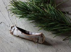 making a birch bark canoe out of real birch bark!