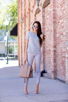 Rachel Parcell Is Wearing Mirrored Sunglasses By Rayban, Top From J. Crew, Trousers By Current/Elliott, Bag From Valentino And Shoes From Ch...