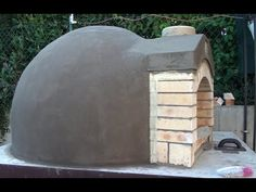 "Time lapse video of construction of our pizza oven. It is Pompeii style one. The oven is on steel / concrete ""table"". We used 300 fireclay bricks and lots of."