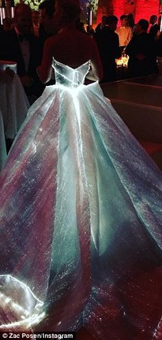 All lit up! The gown's designer proudly shared the dress in its full lit-up glory on his I...