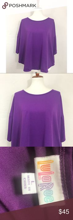 LulaRoe 💕 Solid Purple Excellent Irma top by LulaRoe. Solid purple and no fading or flaws. LuLaRoe Tops
