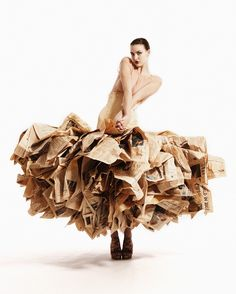 Newspaper Dress: 30 copies of the 'Financial Times' folded and attached to a salmon pink corset to create a 'tulle' skirt. By designer Gary Harvey