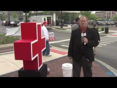 Red cross sign fail . Reporter Doug Wolfe vs wind