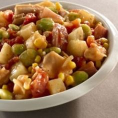 Hearty Slow Cooker Brunswick Stew -  Ingredients  • 2 lb. boneless, skinless chicken thighs, cut into 1-inch cubes  • 1 lb. ham steak, cut into 1-inch cubes  • 2 cans (14.5 oz.) diced tomatoes , undrained  • 1 can [drained] lima beans  • 1 can [drained] whole kernel corn  • 16 oz bag frozen diced potatoes  • 1/2 tsp. crushed red pepper flakes  • 2 envelopes Onion Soup Mix   Directions  1.Combine all ingredients in a slow cooker. Cook covered on LOW 8 to 10 hours or HIGH 4 to 6 hours
