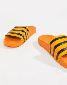 54b4ed6269aa adidas Originals Adilette Slider Sandals In Orange
