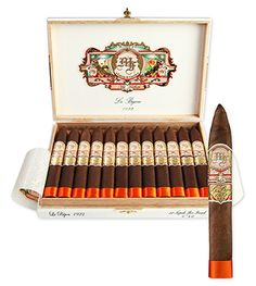 My Father Le Bijou 1922 Cigars by Garcia & Garcia ~ My Father Le Bijou 1922 cigars were blended and produced as a tribute to Don Pepin Garcia's father who was born in 1922. The Le Bijou (The Jewel) cigar features a Nicaraguan Habano Oscuro wrapper from rare Pelo de Oro leaf and a mix of Nicaraguan long-fillers. The medium- to full-bodied Le Bijou is beautifully constructed and well balanced with rich flavors of pepper, spice, cedar, and espresso.