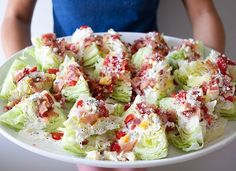Individual wedge salads for a healthy and   unique party appetizer  My son makes fun of wedge salads - we have had them for years.  Yummy with bacon and TI dressing