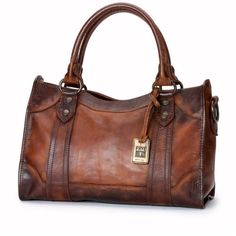 Frye Melissa Satchel.  A classic satchel, this bag was made to match the Melissa button boot.  It's crafted in washed leather with a natural oiled finish that …