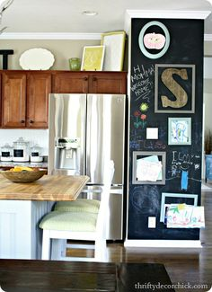 Trays and art on top of kitchen cabinets
