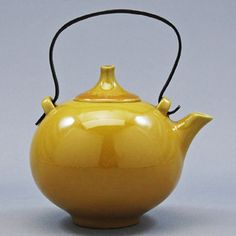 I have a similar yellow teapot in my kitchen. Whenever I look at it it makes me sigh with happiness...: )