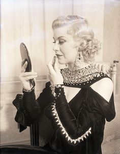 6/11/1933 Hollywood CA A close up of Miss Ginger Rogers in her dressing room making up