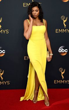 Taraji P. Henson from Best Dressed Stars Ever at the Emmys The Empire star made a statement in a custom, yellow Vera Wang dress at the 2016 Emmy Award. The actress kept her appearance minimal and chic with two subtle and sexy slits on the side. Celebrity Red Carpet, Celebrity Dresses, Celebrity Style, Vera Wang Gowns, Vera Wang Dress, Kevin Costner, Red Carpet Dresses, Blue Dresses, Summer Dresses