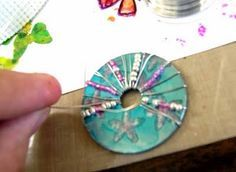 Paint a washer with alcohol ink & blending solution. After the ink dries, use black StazOn and a Fontwerks flower stamp. Working quickly, paint the flowers using pink and silver ink and Blending Solution. Wrap a thin gauge wire strung at various intervals Alcohol Ink Jewelry, Alcohol Ink Crafts, Alcohol Ink Painting, Alcohol Ink Art, Diy Jewelry Tutorials, Jewelry Crafts, Jewelry Ideas, Washer Crafts, Hardware Jewelry