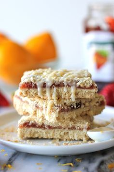 Strawberry Crumb Bars with Meyer Lemon Glaze - These bars are loaded with strawberry jam and topped with a tangy glaze!