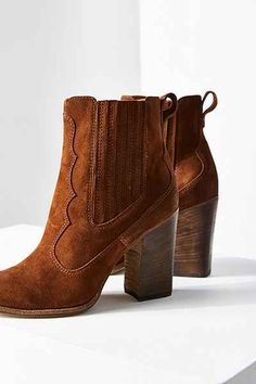 Whether you're dancing in the country or twisting in the city, this ankle boot from Dolce Vita will keep you walking tall. Western-inspired bootie with seamed stitching accents + stretchy elastic gores at sides with a back pull tab, constructed in a soft, rustic suede. Finished with a stacked block heel with rubber cap + sloping sole.