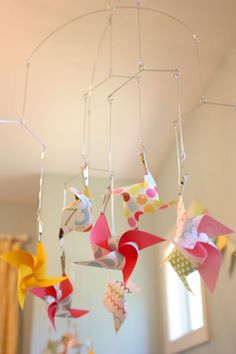 i like the idea of pinwheels in lots of colors but facing down so baby can see Fun, Adorable Batch of DIY Baby Mobiles