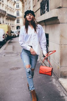 With a half-tucked button-up and torn jeans. - See the outfit details on Natalie Off Duty here. Girl Fashion, Fashion Outfits, Womens Fashion, Fashion Design, Fashion Ideas, Spring Summer Fashion, Spring Outfits, Spring Style, Best White Sneakers