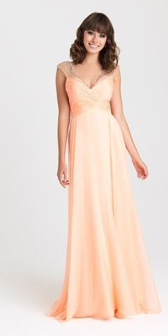 Madison James - 16-334 Dress in Peach. A ruched crossover bodice and beaded cap sleeves add a little something special to this timeless gown. Madison James 16-334 is available in Peach, Royal, & Water. Wear for your 2016 Prom, Homecoming, or other Special Occasion Event! (Ad)
