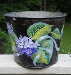 my painting on a beat up sap bucket, Ros Stallcup design