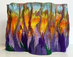 Rebecca Smith has developed her own unique approach to mixed media weaving by combining yarn, beads and wire to produce tapestries, woven sculptures, vessels and jewelry. http://rebeccasmithtapestry.com/index.htm