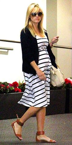 Pregnant actress Reese Witherspoon leaves an office building in Beverly Hills, California on May 3rd, 2012.