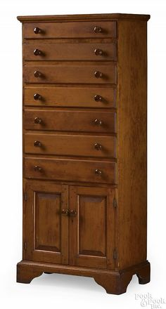 Shaker pine 1-piece wall cupboard, ca. 1820, the molded cornice over 7 drawers over 2 raised panel cupboard doors, resting on cutout bracket feet.
