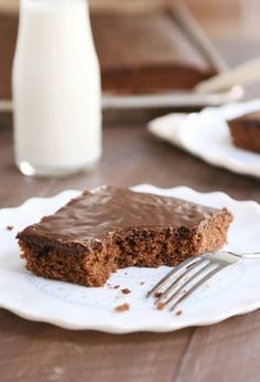 """My favorite """"take"""" on classic chocolate Texas sheet cake, this delightful cake is so moist, ultra-chocolatey, and so easy to make (no mixer required! Texas sheet cake is a funny little cake. I remember my mom Super Moist Chocolate Cake, Chocolate Flavors, Chocolate Cakes, Yummy Treats, Sweet Treats, Delicious Desserts, Glass Baking Pan, Sheet Cake Recipes, Sheet Cakes"""