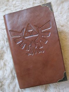 Custom Legend of Zelda Hylian Royal Crest Leather Bound Journal. $40.00, via Etsy.
