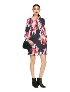 our new hazy floral fabric sets richly-hued, painterly blooms against a dark background; this dress, with its flowing long sleeves and high neckline, is perfect for drinks, dinner or the office holiday party.