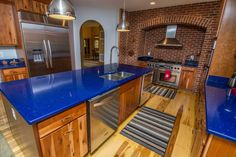 Definitely one of the most unique kitchens on the market, the blue countertops and brick details provide a refreshing contrast with the stainless steel appliances. The island makes it easy to navigate the kitchen and provides extra counter space. This awesome home is located in the Highline community near Wisp Resort in the Deep Creek Lake area!