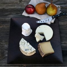 Here's a selection of four of the world's most exquisite cheeses: Fourme d'Ambert AOC, Boschetto al Tartufo Bianchetto, Green Peppercorn Cone by Coach Farm, and Le Marechal.