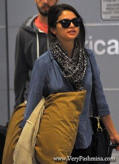 #SelenaGomez Travels To JFK Airport In A Black And White #Scarf
