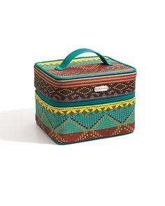 Designed for jet-setters and road-trippers, this super-spacious Jewelry Tote from the Accessories Collection can go everywhere you do. It has a colorful print, a zip closure and can store 15-20 various jewelry items. Plus, it comes with a convenient loop on top that makes for easy in-hand carrying or hanging.