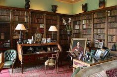 The desk was from Napoleon's aide de camp and was originally in Lansdowne House in London.  This room holds over 5,000 books. Placed around the room are green leather chairs.
