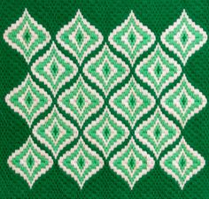 Vintage Bargello Needlepoint Abstract Design in Green Op Art Unconventional Holiday Decor Wall Hanging. $26.00, via Etsy.