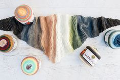 """Make an easy crochet triangle scarf with this free Lion Brand Mandala scarf pattern. This one skein crochet project makes a perfect, fast gift. Video tutorial in the color """"Serpent."""""""