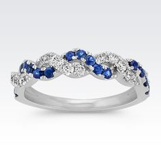 This gorgeous ring features a braided twist of 15 round traditional blue sapphires (approx. .34 carat TW) and 15 round diamonds (approx. .26 carat TW). As the two pavé-set gemstones intermix together, they reflect off each other and create intriguing sparkle and brilliance. The beautiful ring is crafted of quality 14 karat white gold and has a total gem weight of approximately .60 carat.