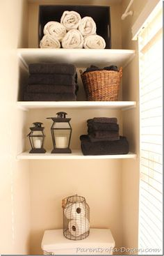 bathroom shelves - can also add a neatly stacked toilet paper tower.